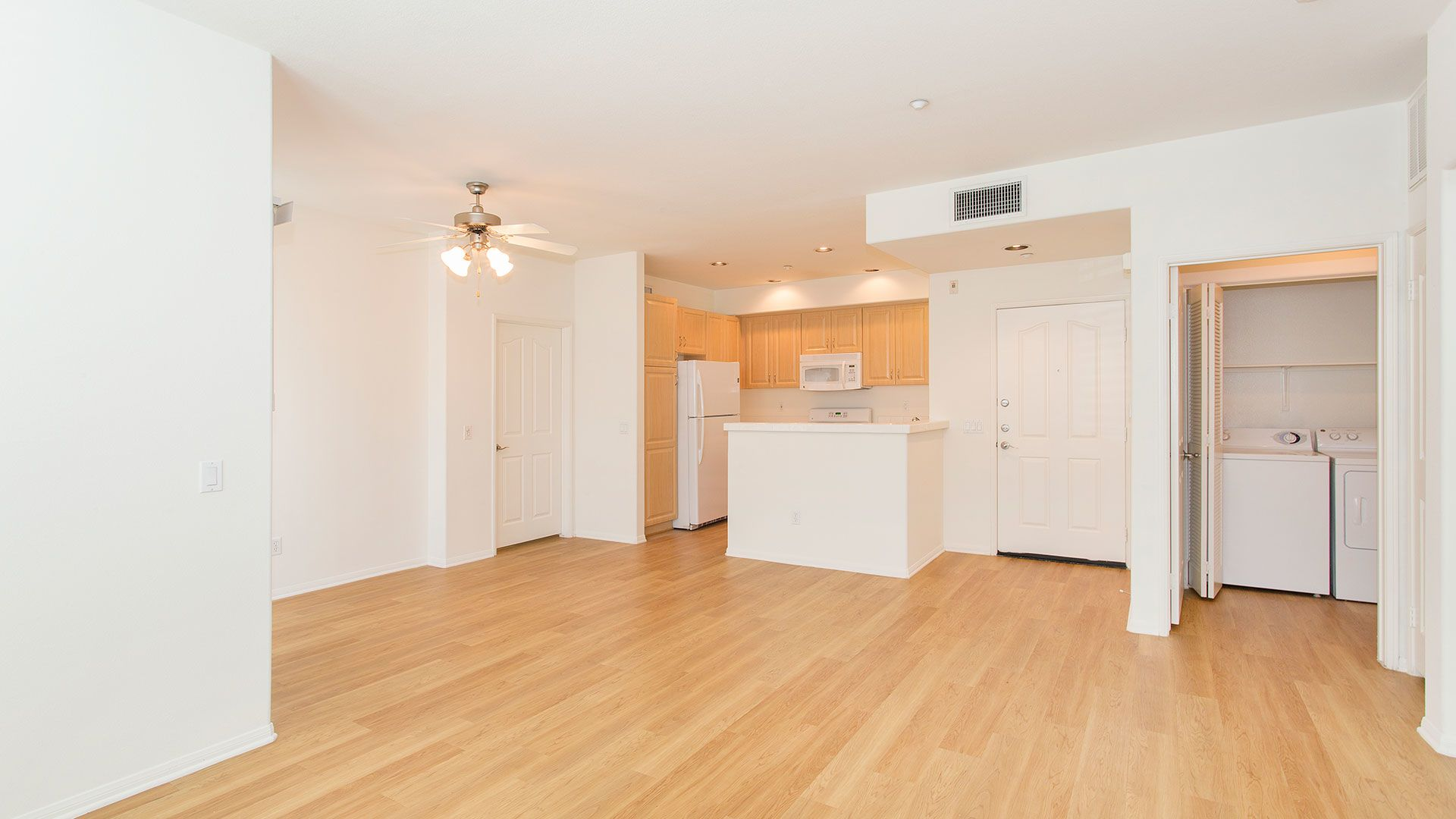 Via Ventura Apartments - Living Room, Kitchen and In-home Washer/Dryer