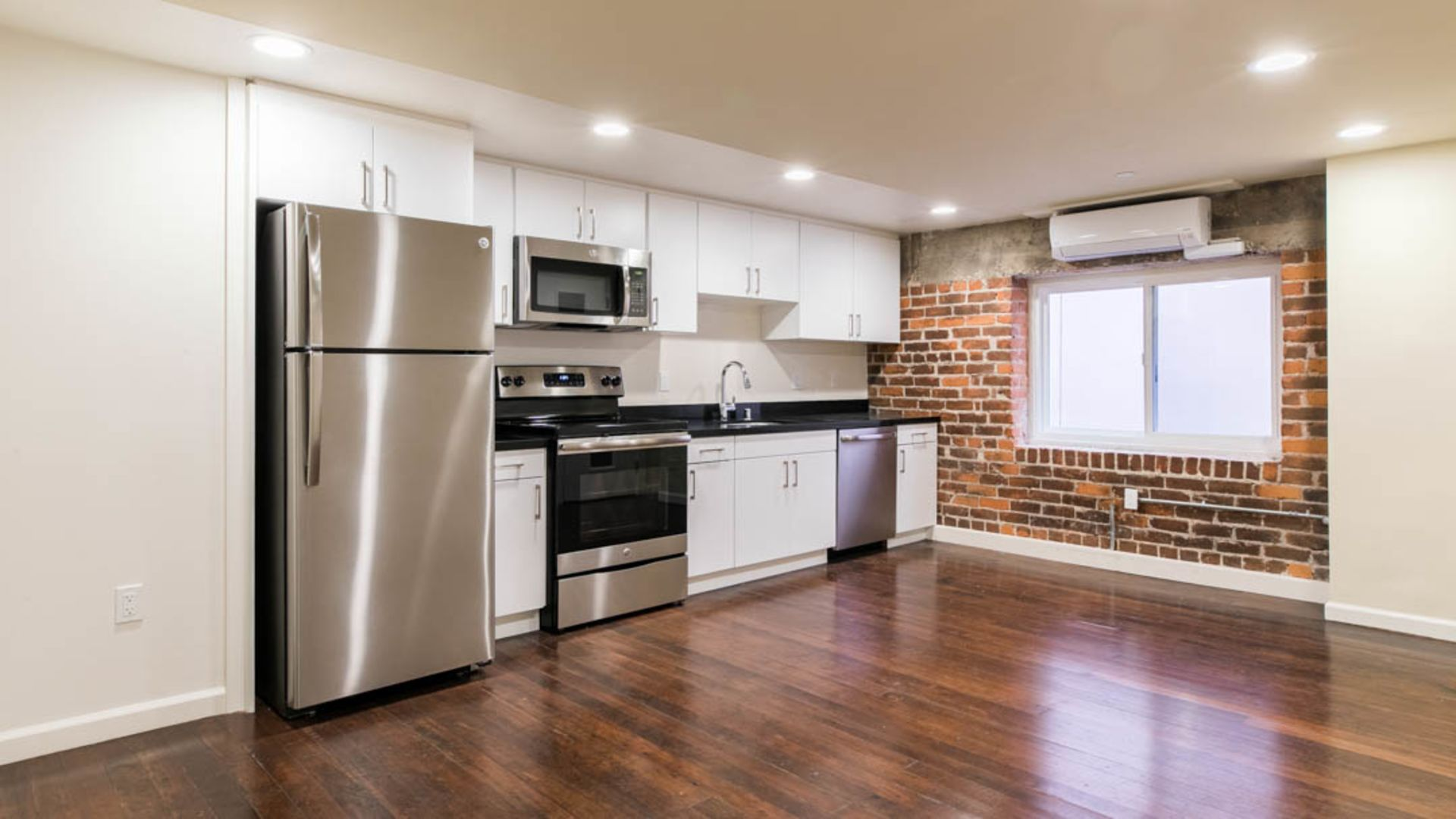 Vintage at 425 Broadway Apartments - Kitchen and Living Area