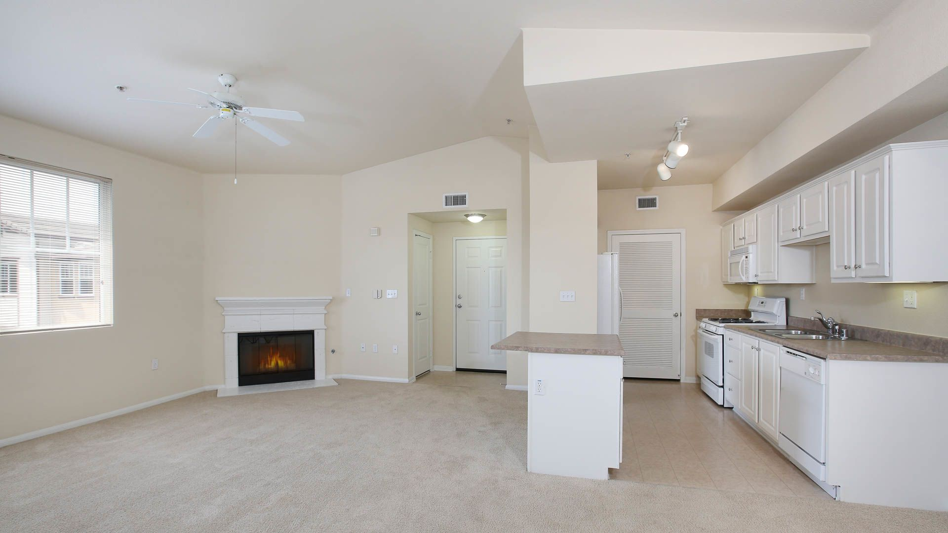 The Reserve at Empire Lakes Apartments - Kitchen and Living Room