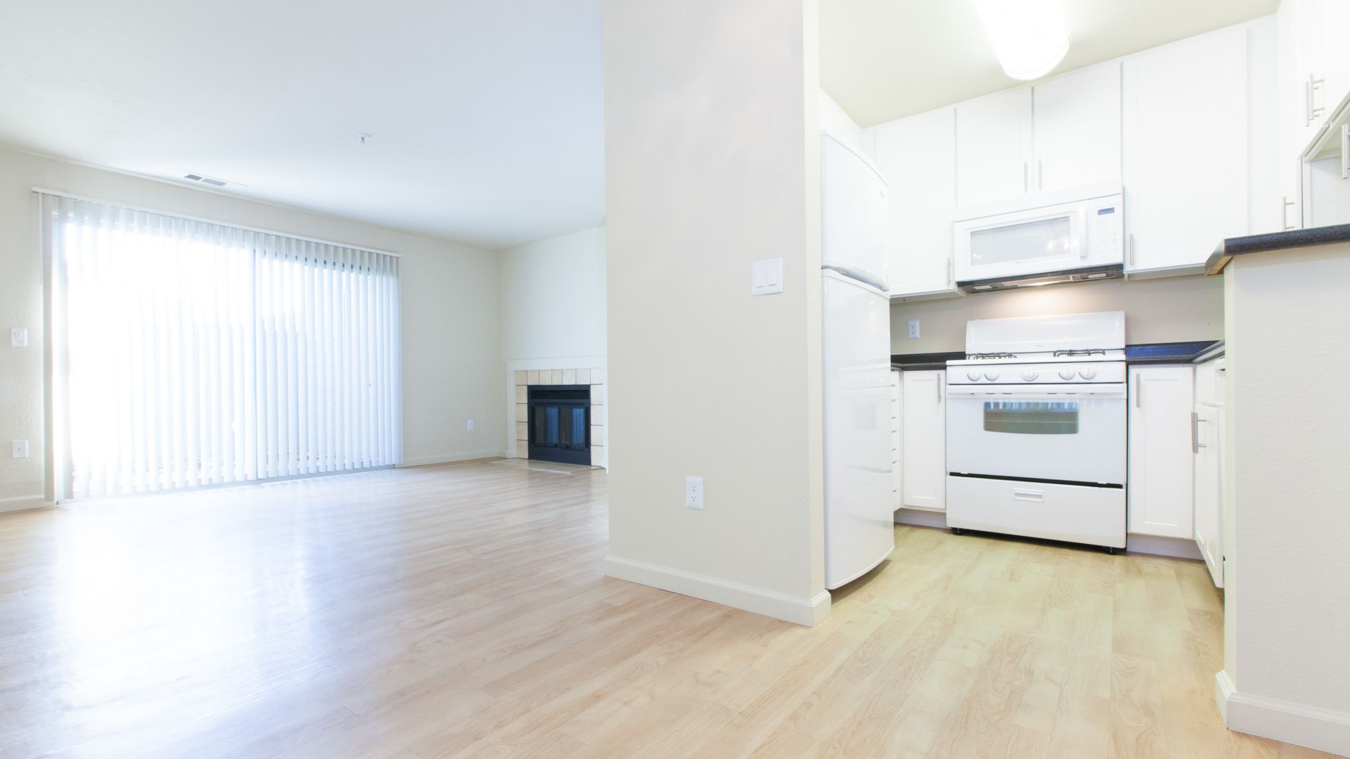 Lantern Cove Apartments - Kitchen and Living Room
