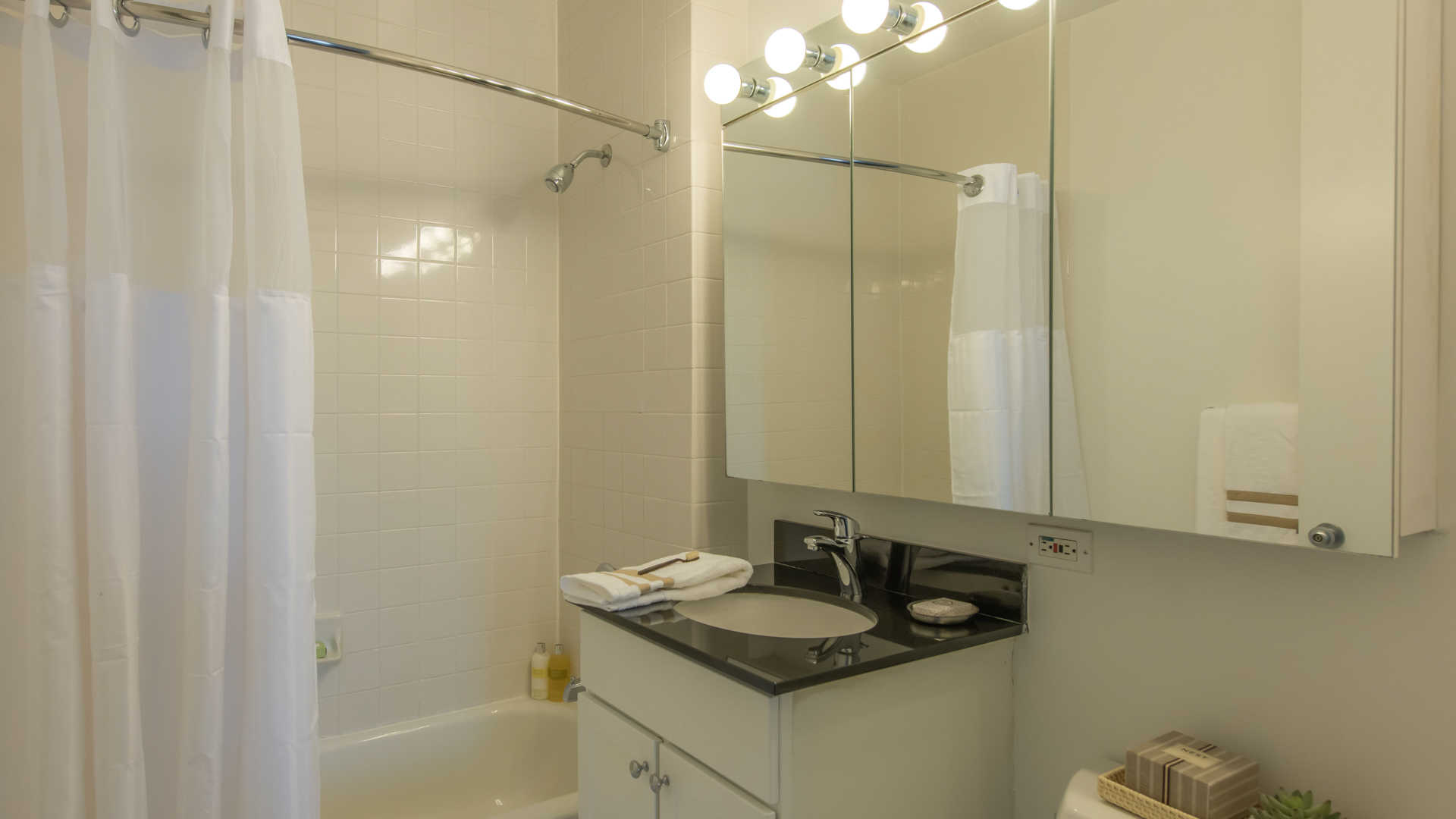 Bathroom with Vanity and Floor to Ceiling Tile