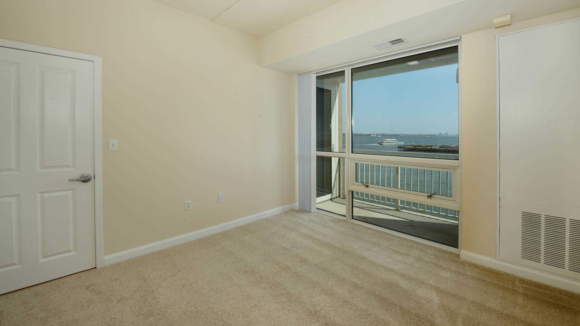 Carpeted Living Room with Balcony