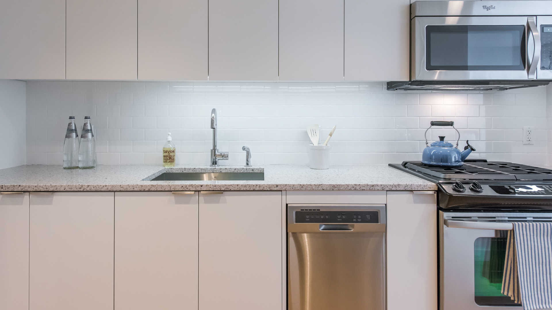 Kitchen with Stainless Appliances and Undermount Lighting