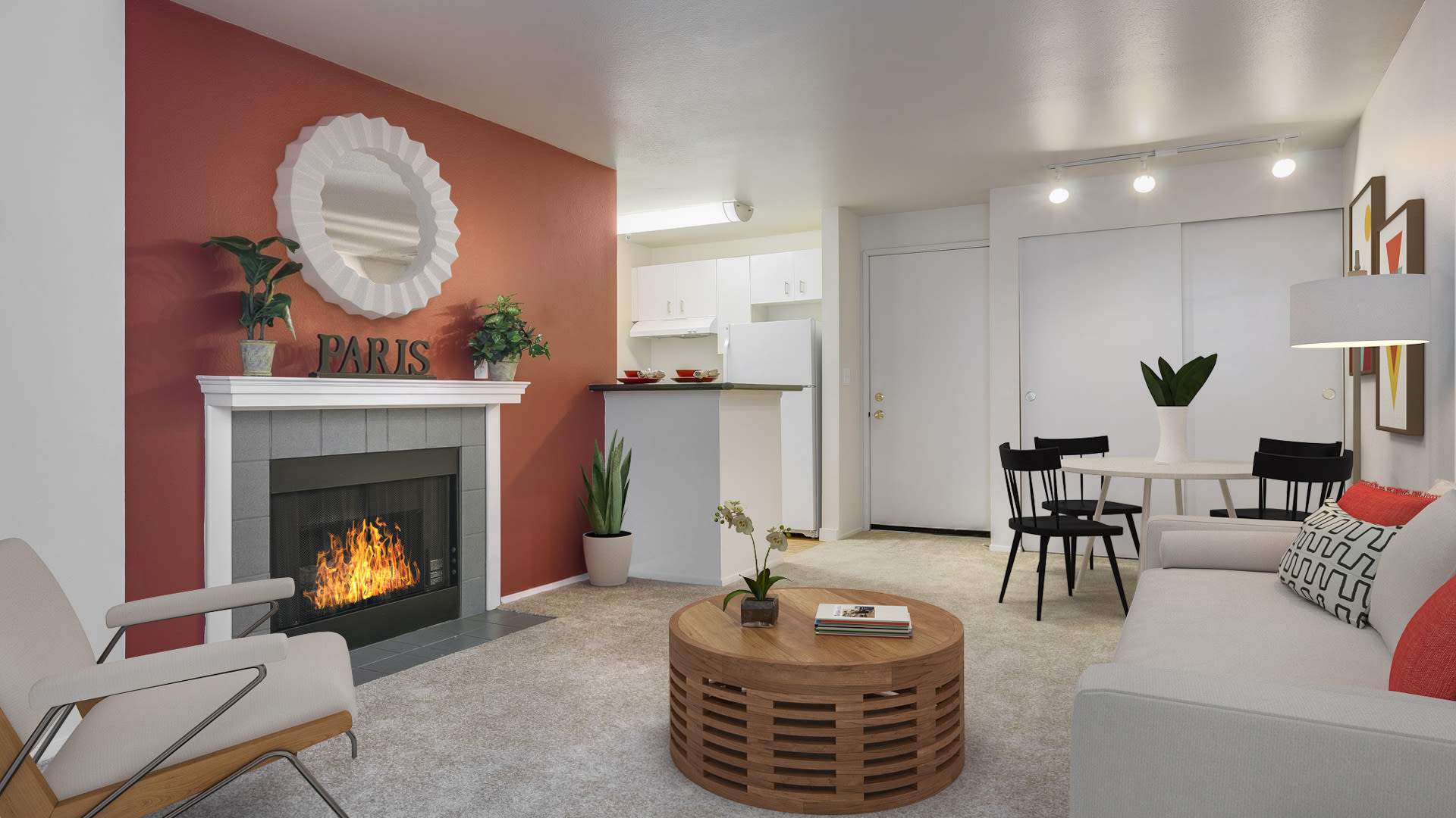 Seventh and James Apartments - Carpeted Living Room with Fireplace