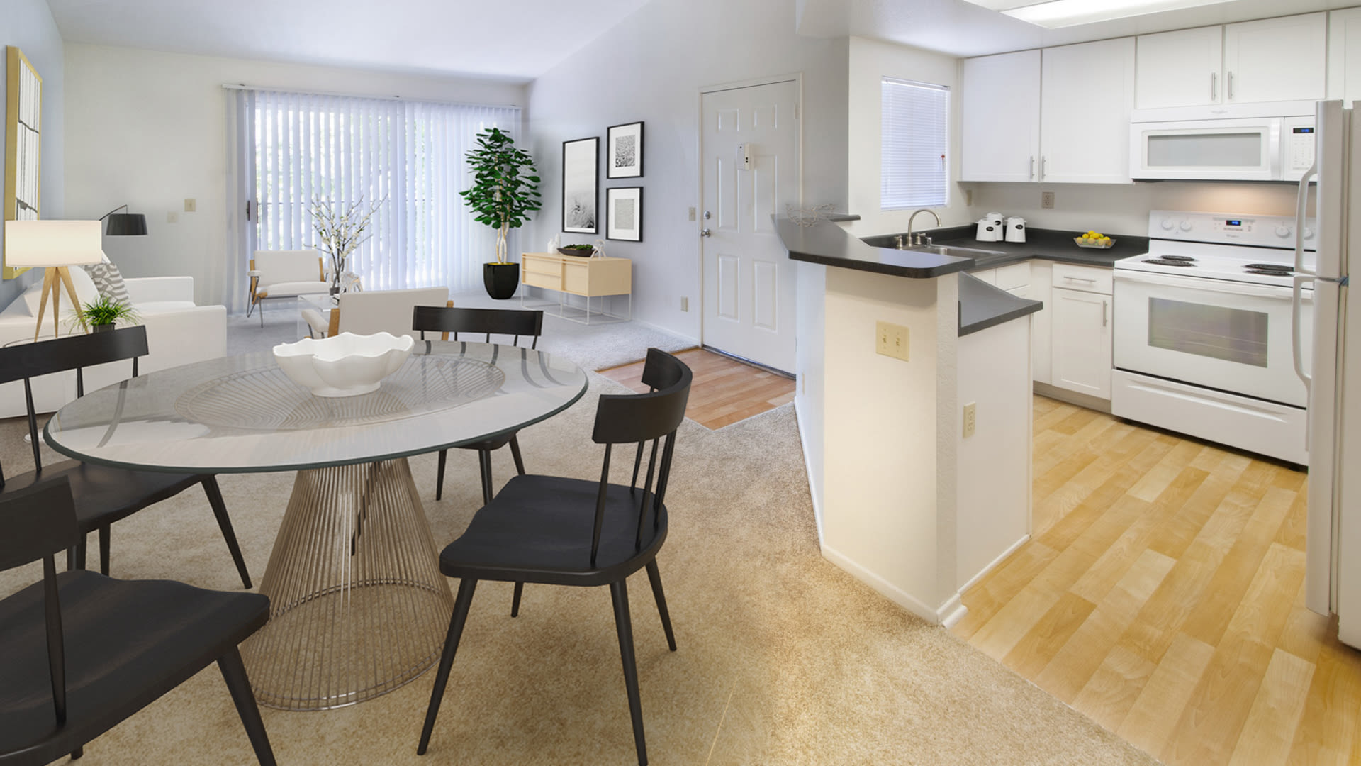 Siena Terrace Apartments - Kitchen and Carpeted Living Room with Balcony