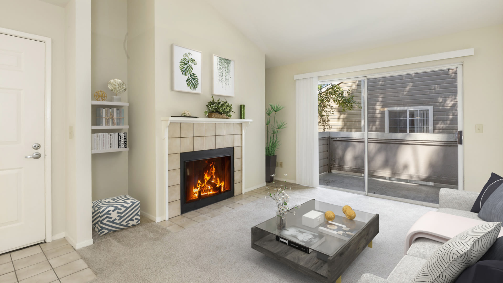 Canyon Creek Apartments - Carpeted Living Room with Wood-burning Fireplace and Balcony
