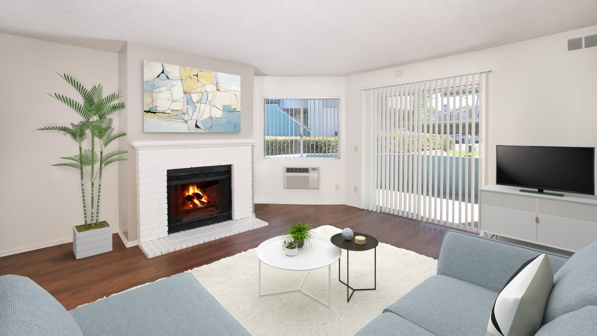 Villa Solana Apartments - Living Room with Hard Surface Flooring, Fireplace and Balcony