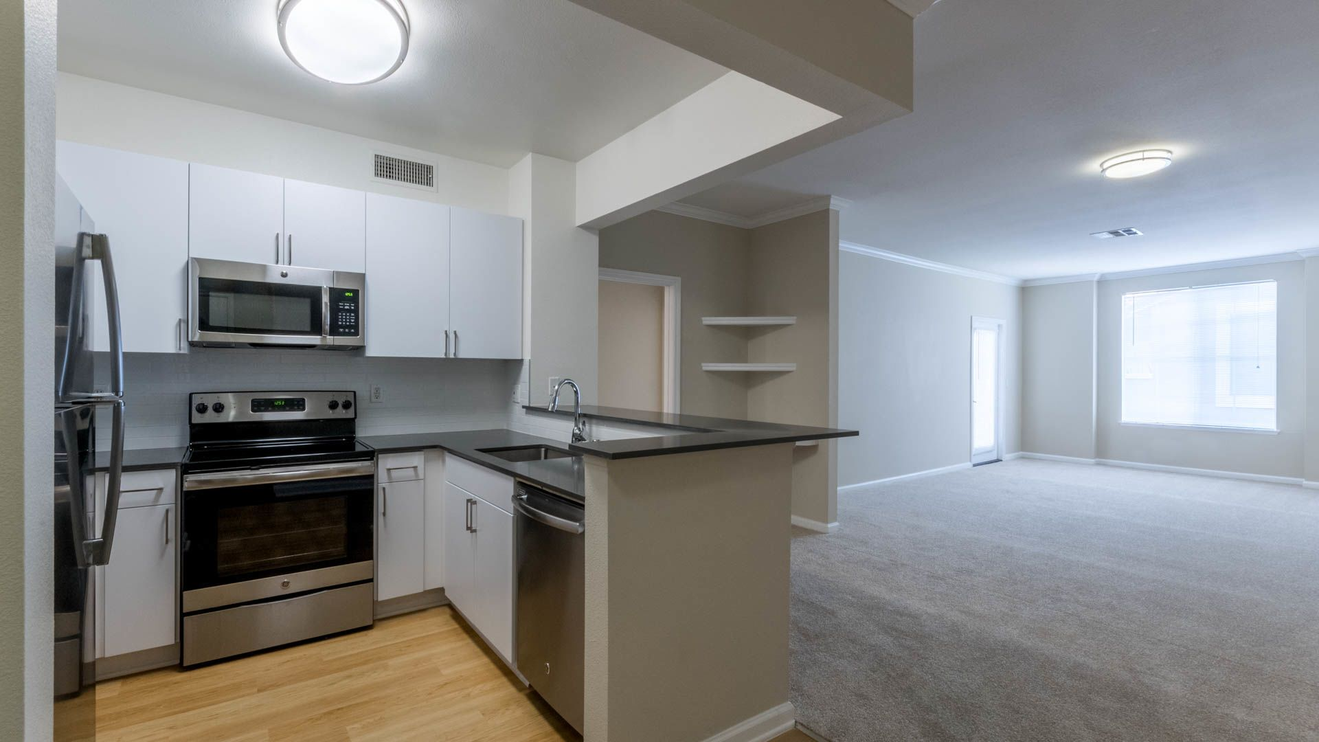 Promenade at Town Center Apartments - Kitchen and Living Area