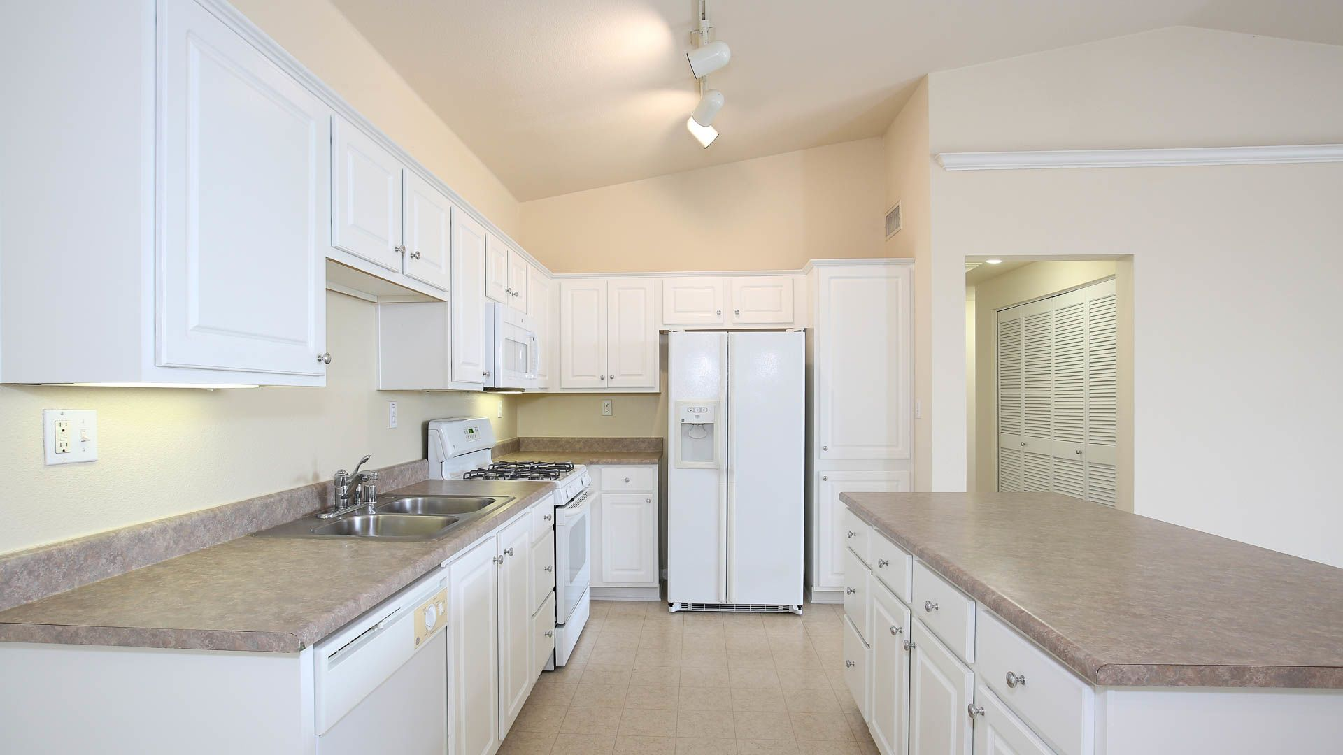 The Reserve at Empire Lakes Apartments - Kitchen