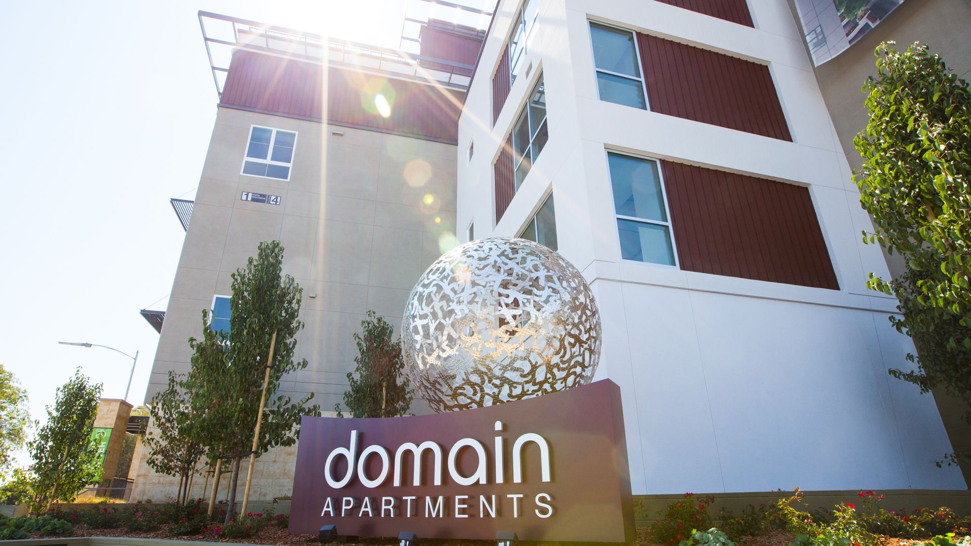 Domain Apartments - Building and Sign