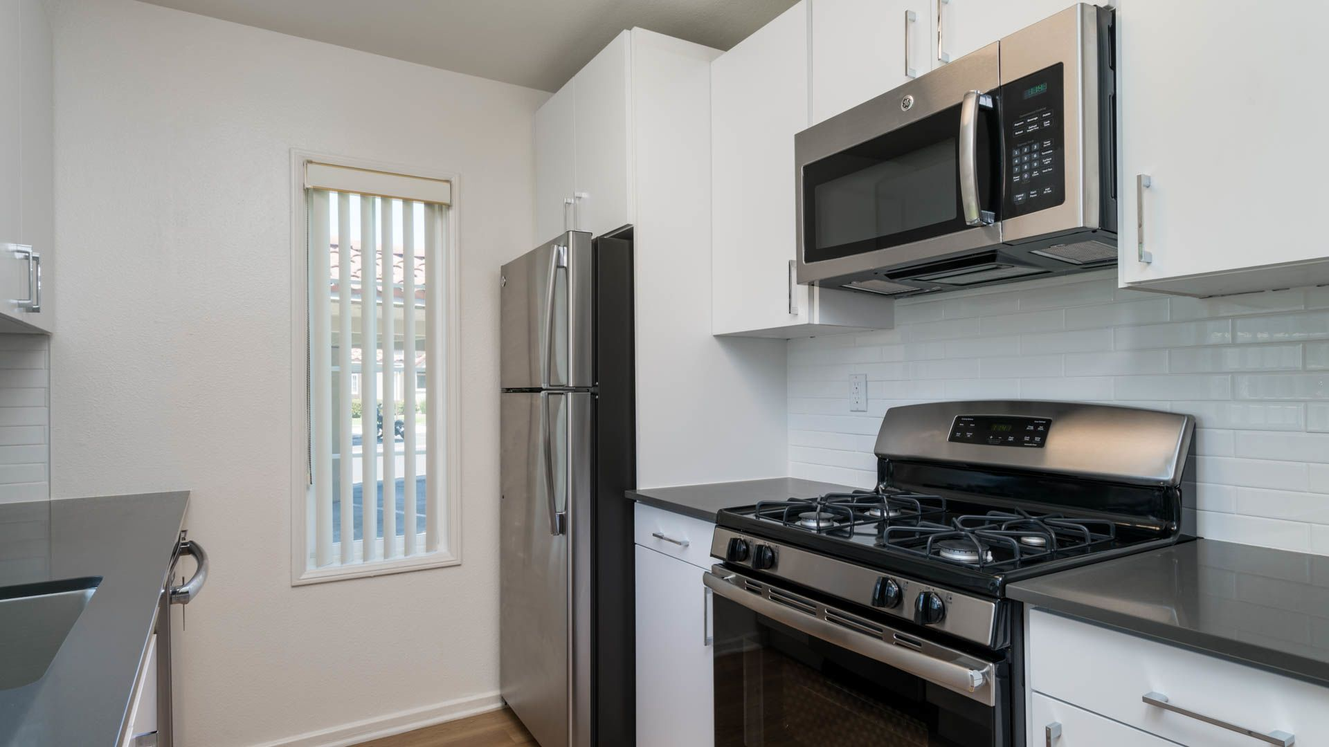 The Village at Del Mar Heights Apartments - Kitchen