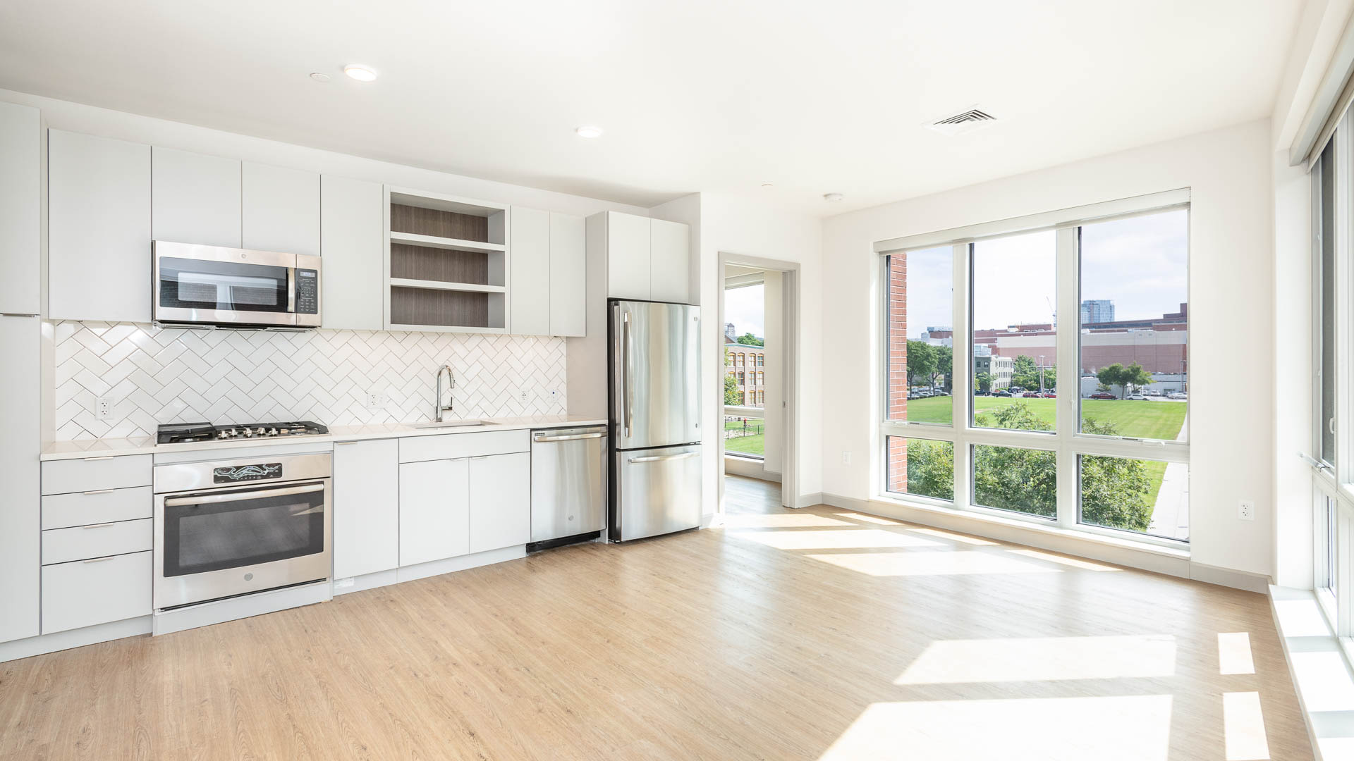 Lofts at Kendall Square Apartments - Kitchen and Living Area