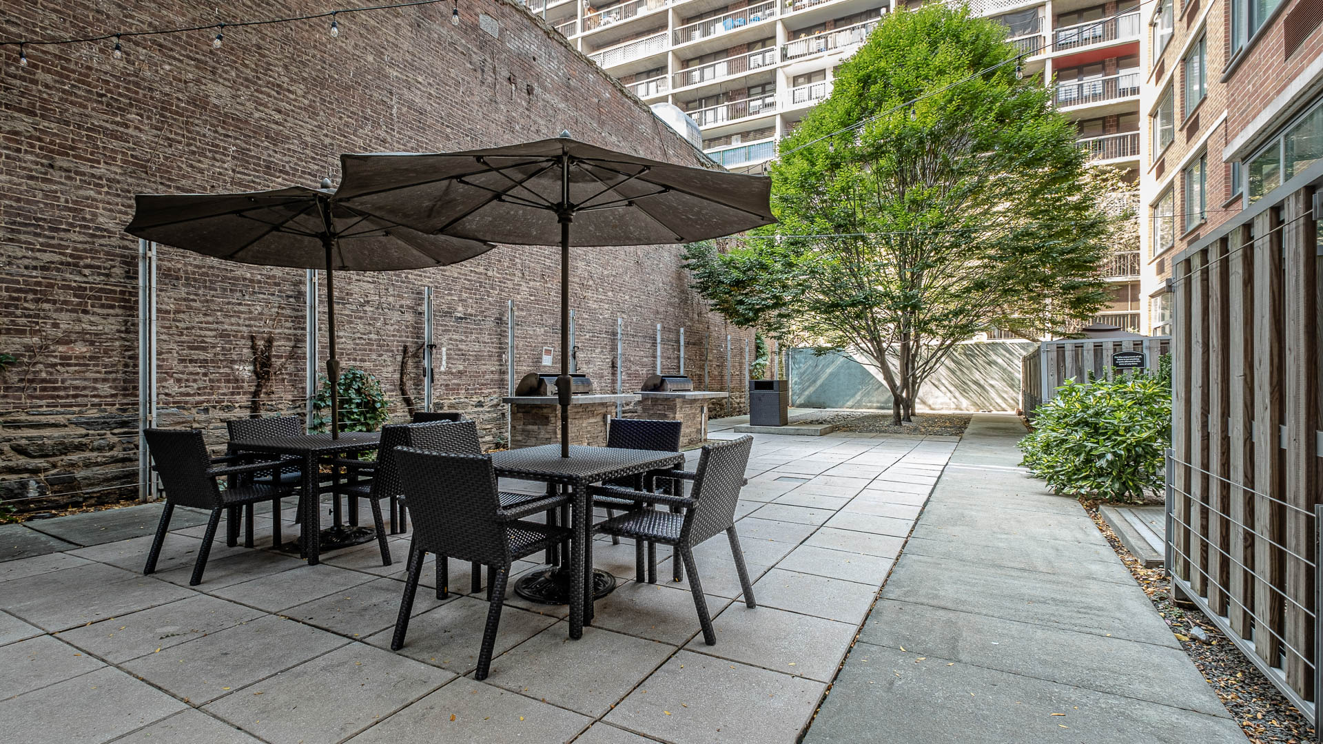 West 54th Apartments - Community Patio and Grilling Area