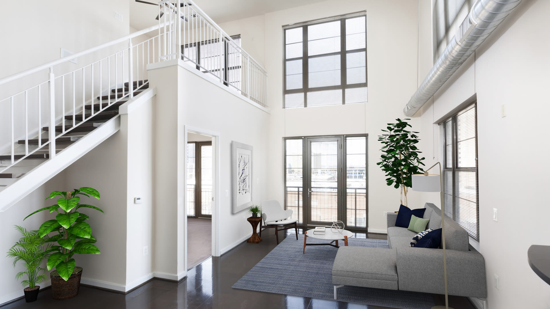 Lofts 590 Apartments - Living Room with Cork and Polished Concrete Flooring and Ceiling Fans