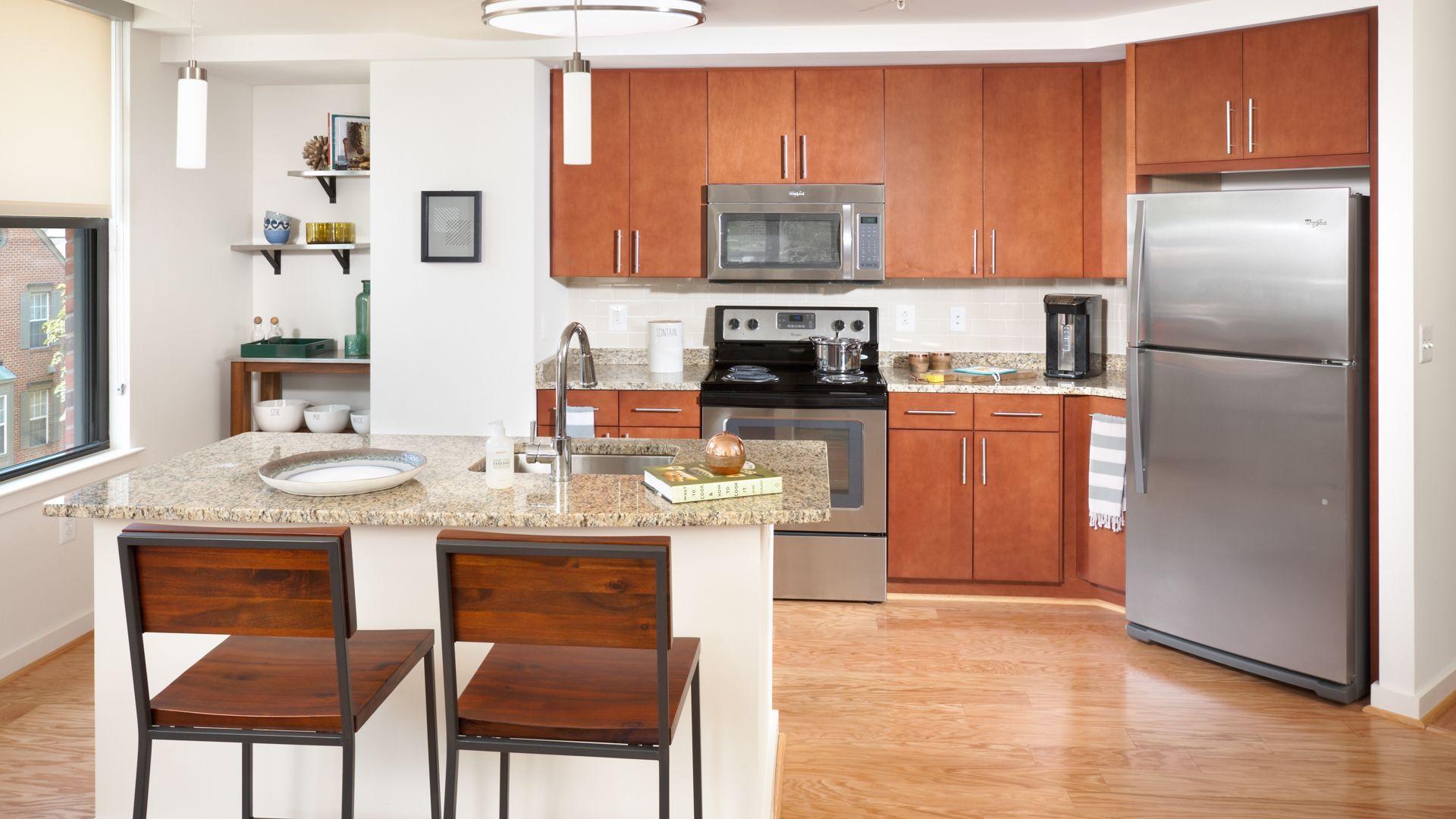 1111 Belle Pre Apartments - Kitchen