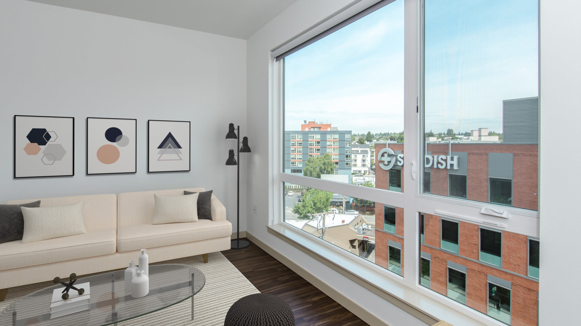 Odin Apartments - Living Room with Hardwood Floors and Floor-to-Ceiling Windows