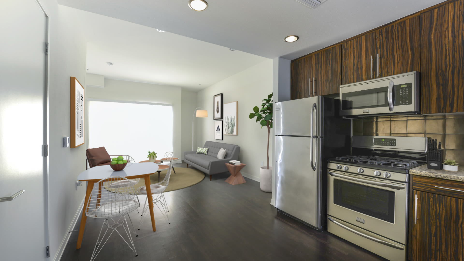 C on Pico Apartments - Dining Room and Kitchen with Stainless Steel Appliances