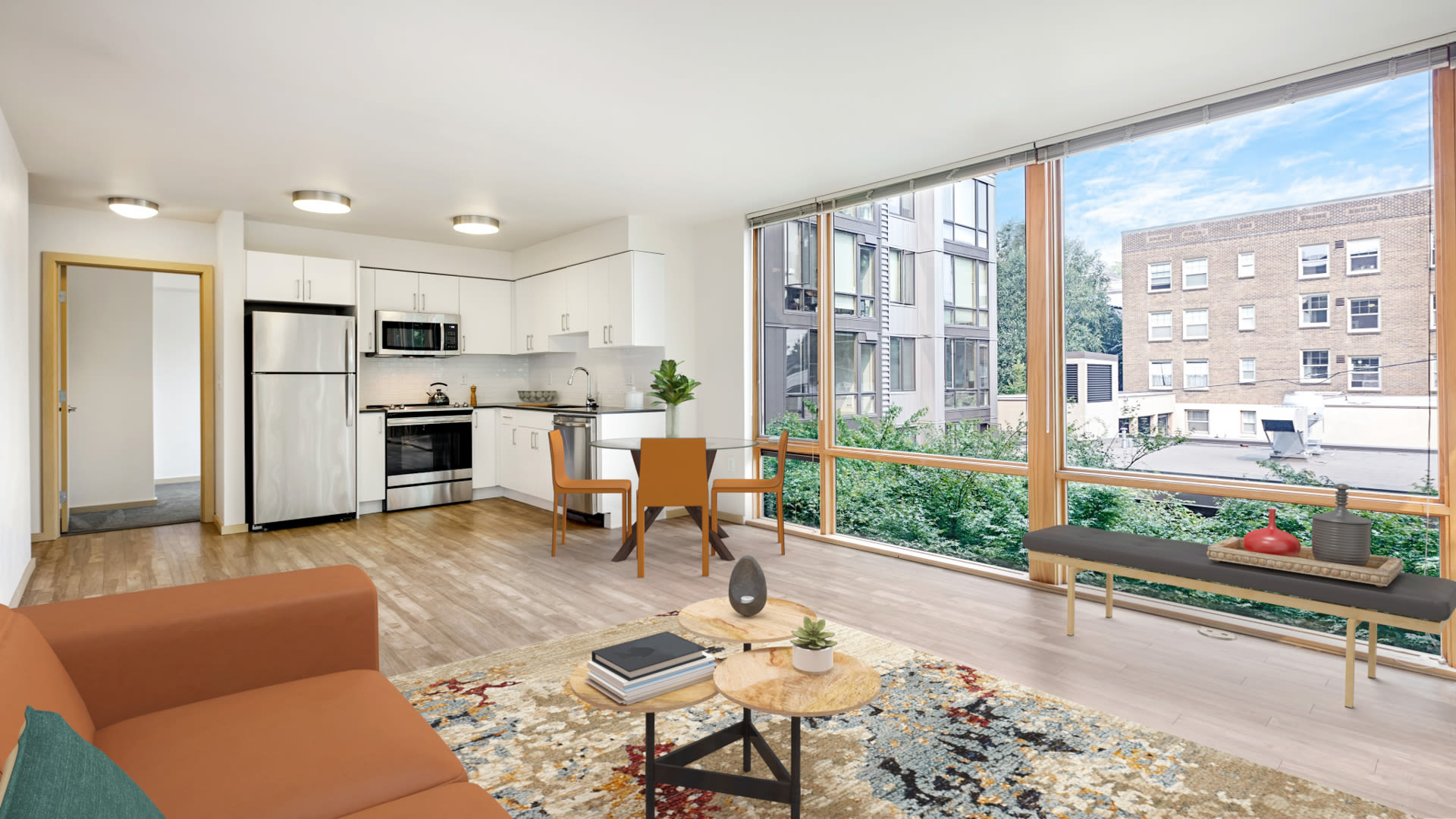 Chloe on Union Apartments - Kitchen and Living Room with Floor-to-Ceiling Windows