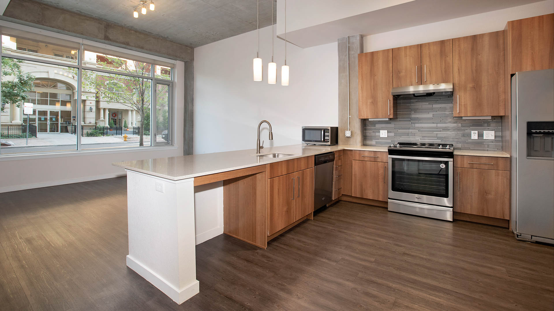 Radius Uptown Apartments - Kitchen and Living Area