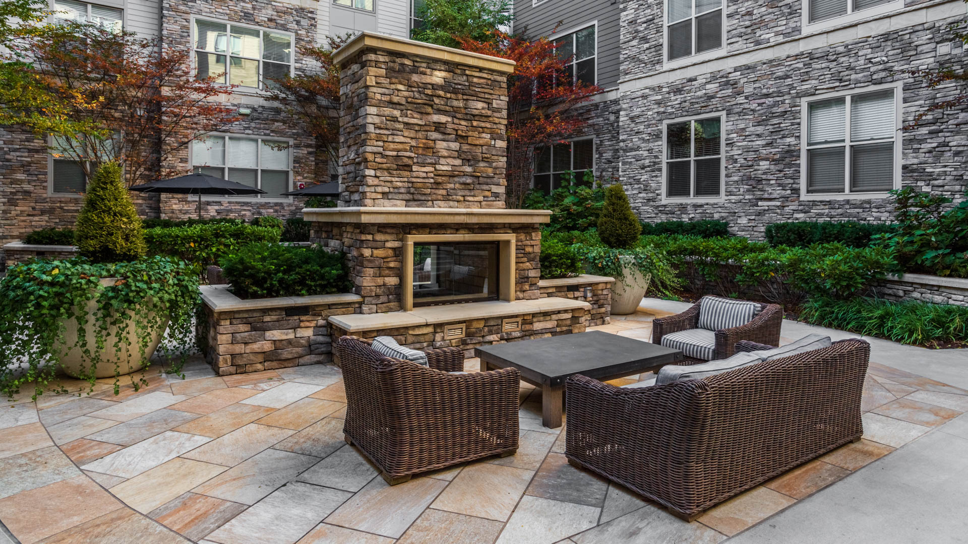 Axis at Shady Grove Apartments - Courtyard with Fireplace