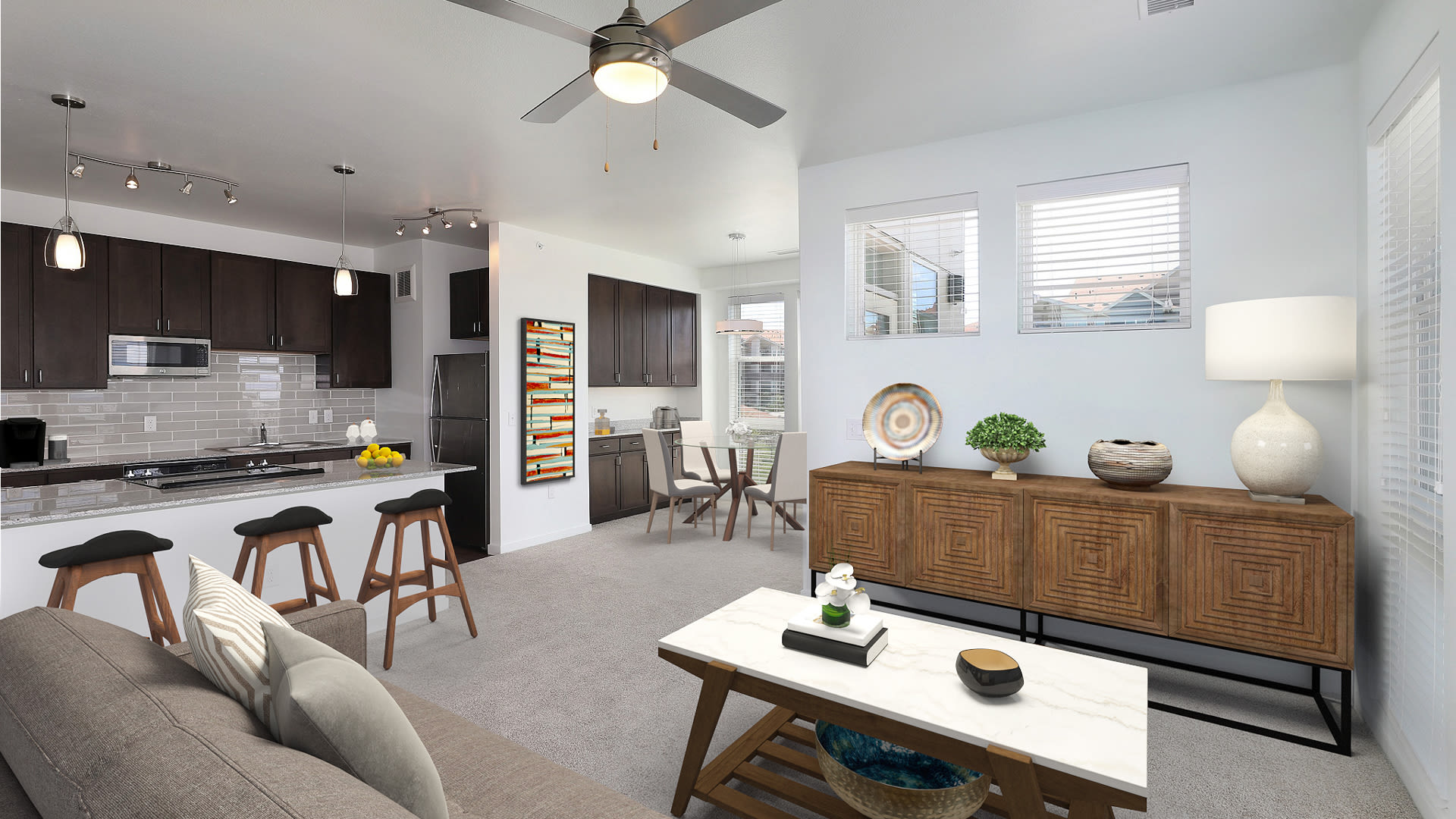 The Brodie Apartments - Kitchen and Carpeted Living Room