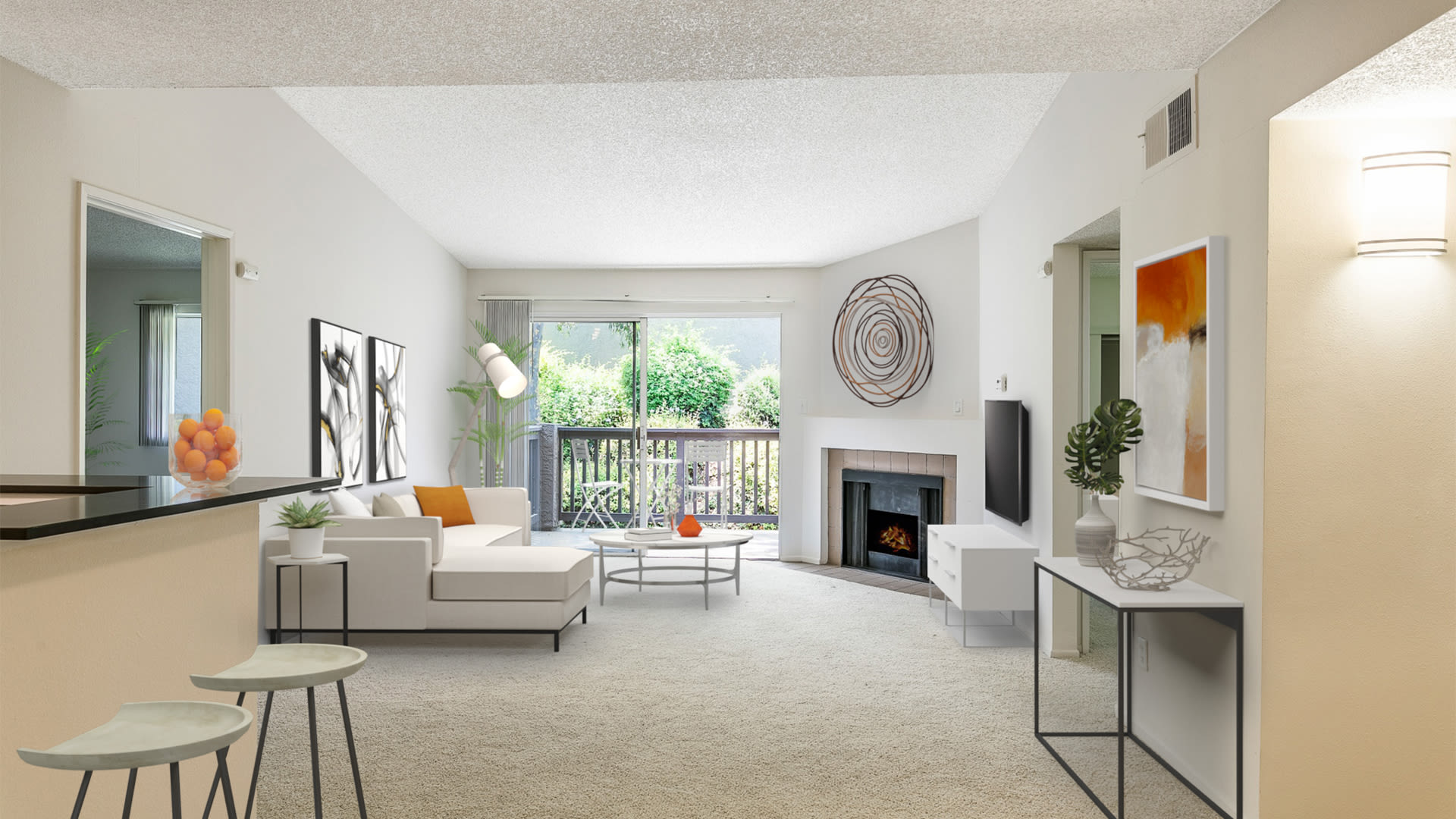 Hathaway Apartments - Carpeted Living Room with Fireplace and Balcony