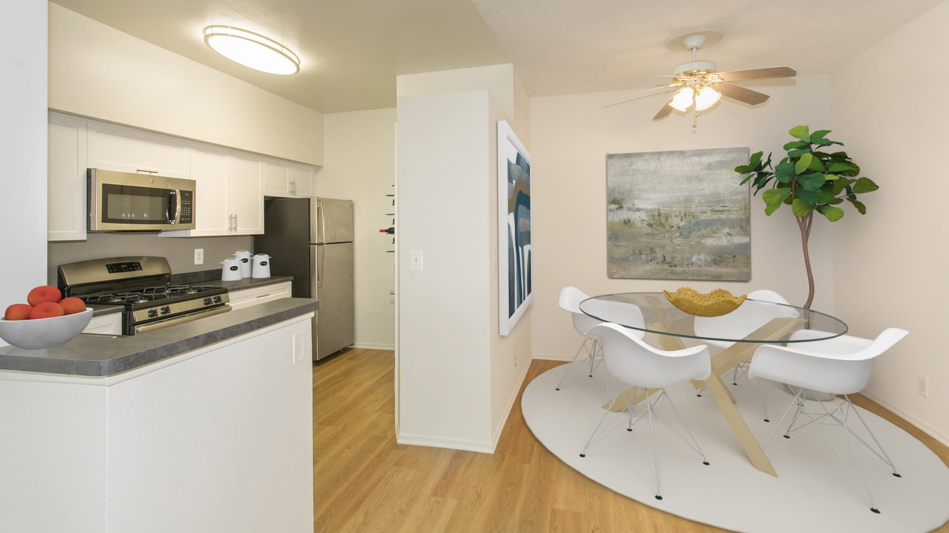 Portofino Valencia Apartments - Dining Room and Kitchen with Stainless Steel Appliances