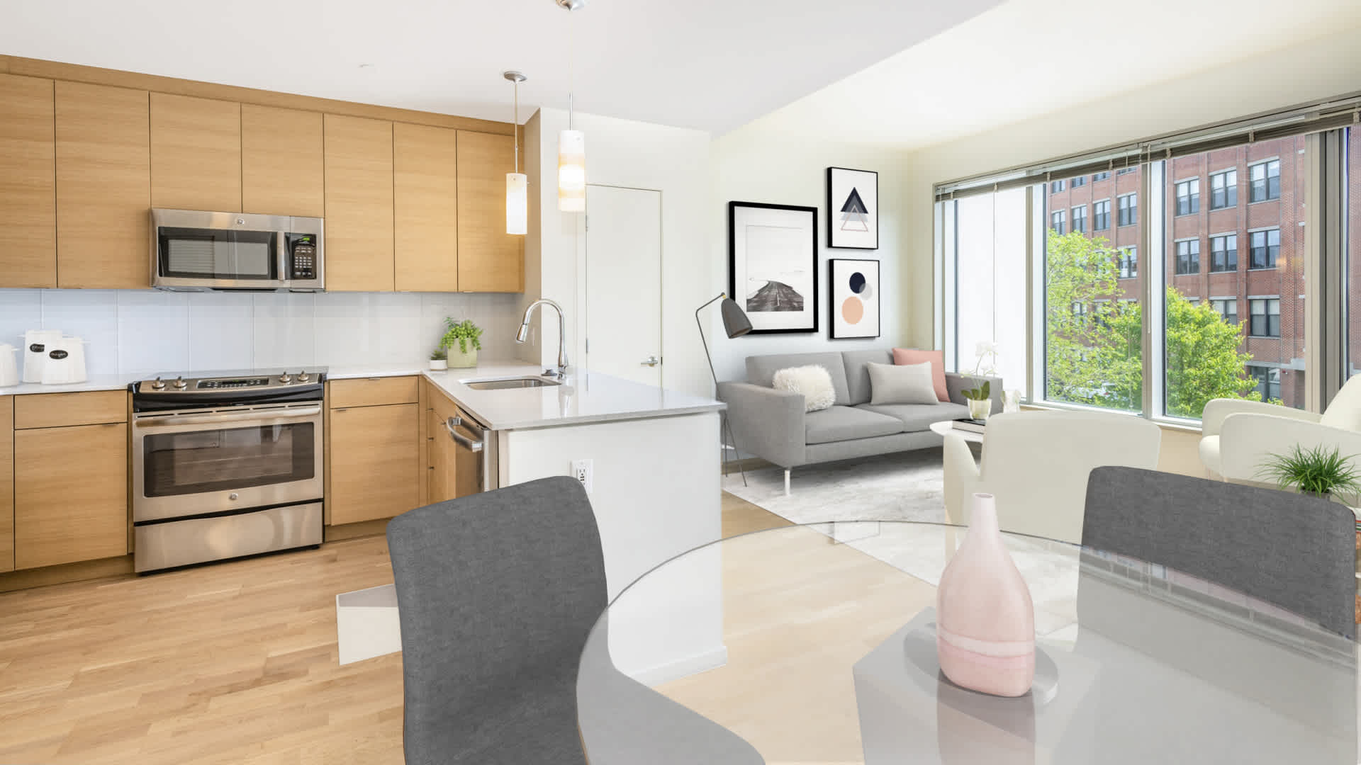 Girard apartments living room and kitchen with stainless steel appliances